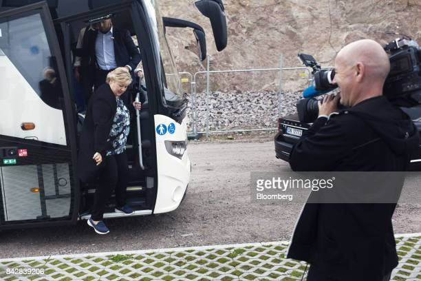 Erna Solberg Norway's prime minister arrives at the construction site for the Stleheia sustainable data center during her Conservative Party election...