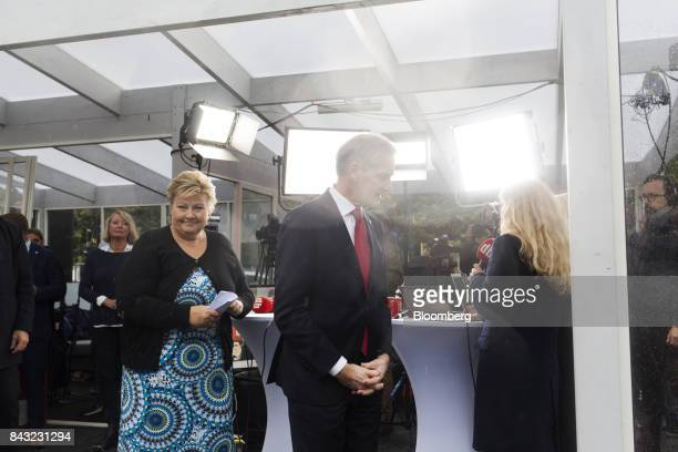 Erna Solberg Norway's prime minister left and Jonas Gahr Store leader of Norway's Labor Party exit after taking part in a televised political debate...