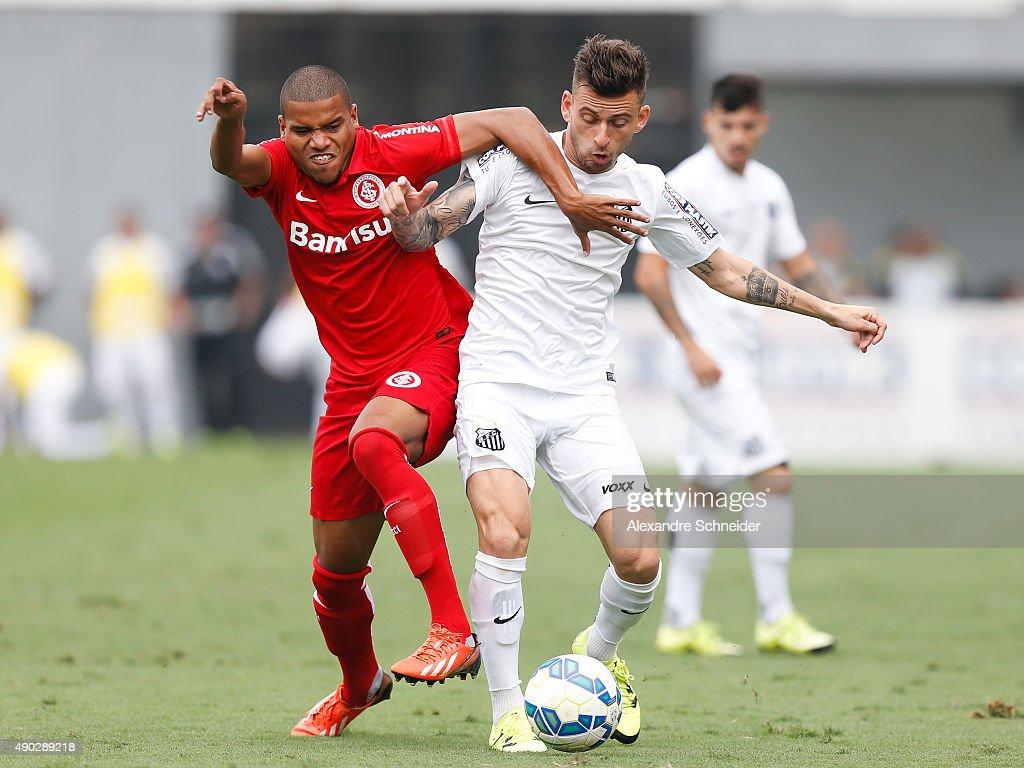 Ernando (L) of Internacional and Lucas Lima of Santos in action during the match between Santos and Internacional for the Brazilian Series A 2015 at Vila Belmiro stadium on September 27, 2015 in Santos, Brazil.