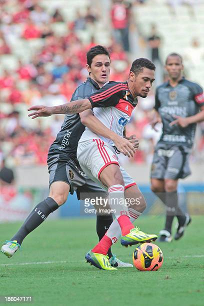 Ernani of Flamengo and Lima of Portuguesa in action during the match between Flamengo and Portuguese for the Brazilian Championship Serie A in 2013...