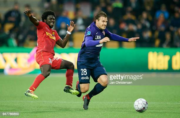 Ernest Asante of FC Nordsjalland and Erik Sviatchenko of FC Midtjylland compete for the ball during the Danish Alka Superliga match between FC...