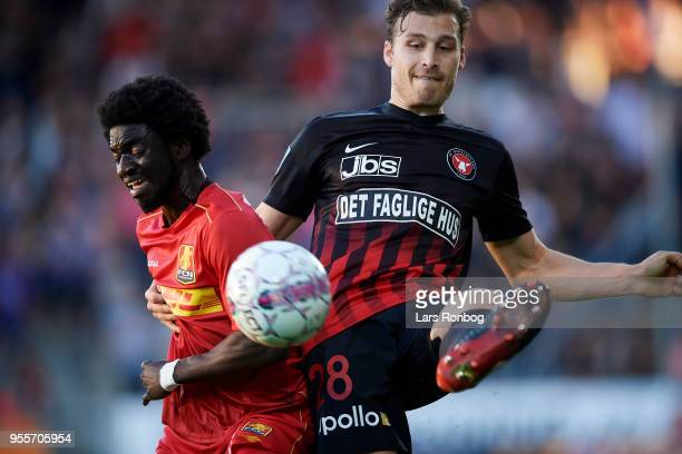 Ernest Asante of FC Nordsjælland and Erik Sviatchenko of FC Midtjylland compete for the ball during the Danish Alka Superliga match between FC...