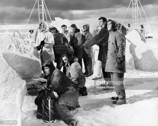 Ernest Borgnine and Rock Hudson have located a strategic space capsule frozen in the ice in a scene from the film 'Ice Station Zebra' 1968