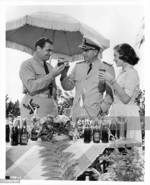 Ernest Borgnine Glenn Ford and Diane Brewster join in a happy salute in a scene from the film 'Torpedo Run' 1958
