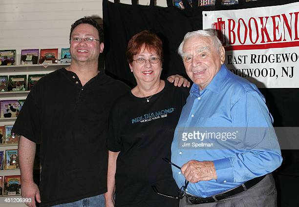 Ernest Borgnine poses with fans during a booksigning of Ernie: The Autobiography at Bookends on August 13, 2008 in Ridgewood, New Jersey.