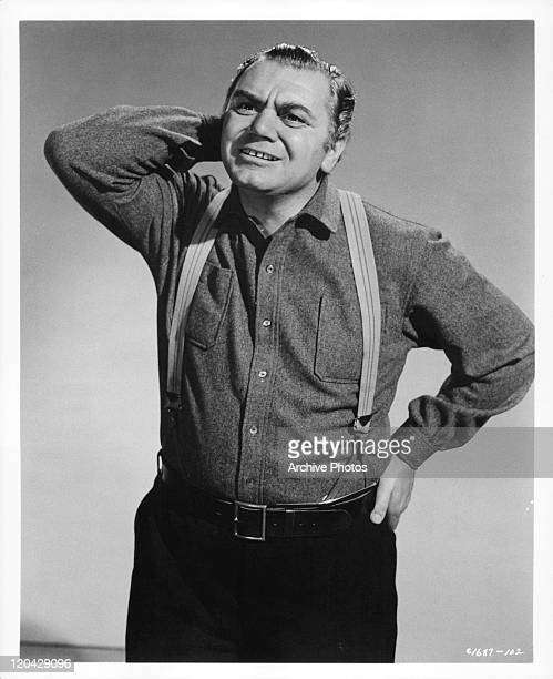 Ernest Borgnine scratching the back of his head in a scene from the film 'The Catered Affair' aka 'Wedding Breakfast' 1956