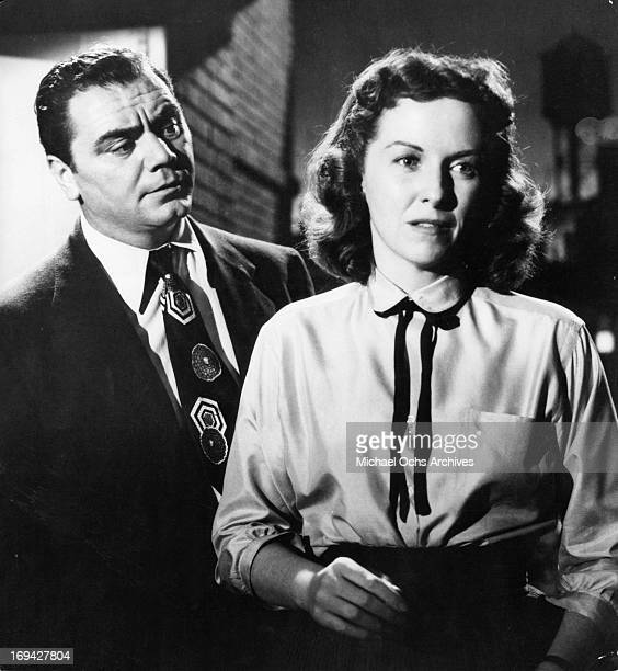 Ernest Borgnine standing behind Betsy Blair in a scene from the film 'Marty' 1955