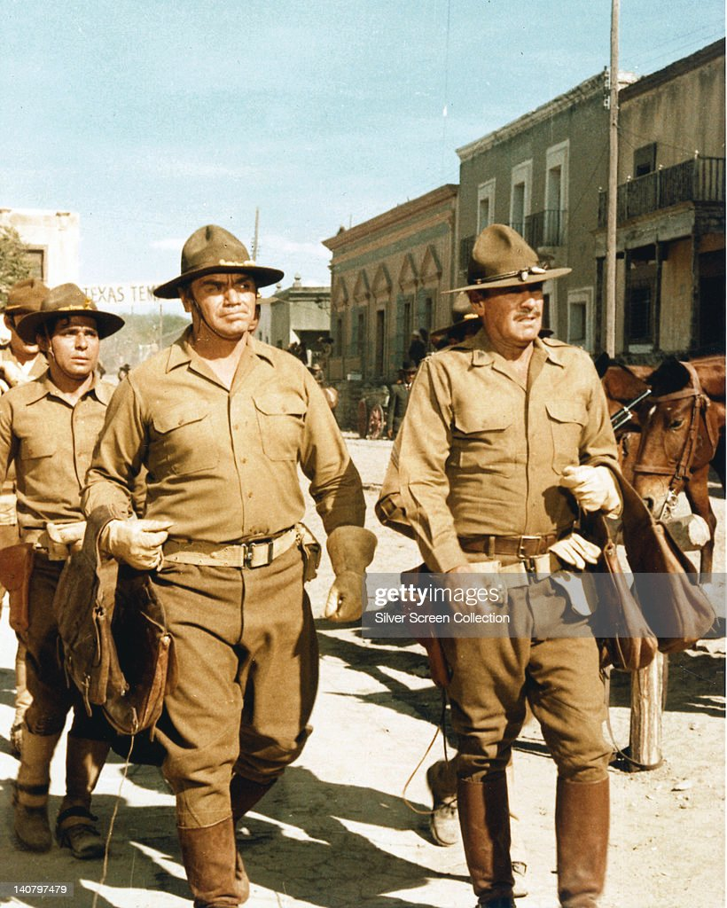 Ernest Borgnine, US actor, and William Holden (1918- 1981), US actor, both in costume in an image issued as publicity for the film, 'The Wild Bunch', 1969. The western, directed by Sam Peckinpah (1925-1984), starred Borgnine as 'Dutch Engstrom', and Holden as 'Pike Bishop'.