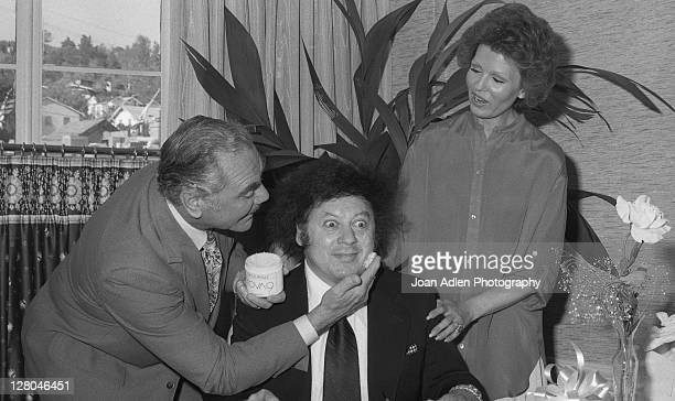 Ernest Borgnine with wife Tova and Marty Allen at launch party her Tova 9 cactus masque on May 12 1978 at the in Los Angeles California