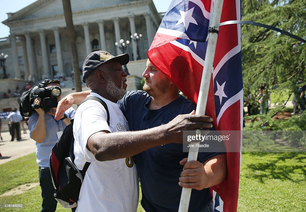 Calls For Removal Of Confederate Flag Outside SC Statehouse Grow In Wake Of Race-Fueled Charleston Church Shooting : News Photo