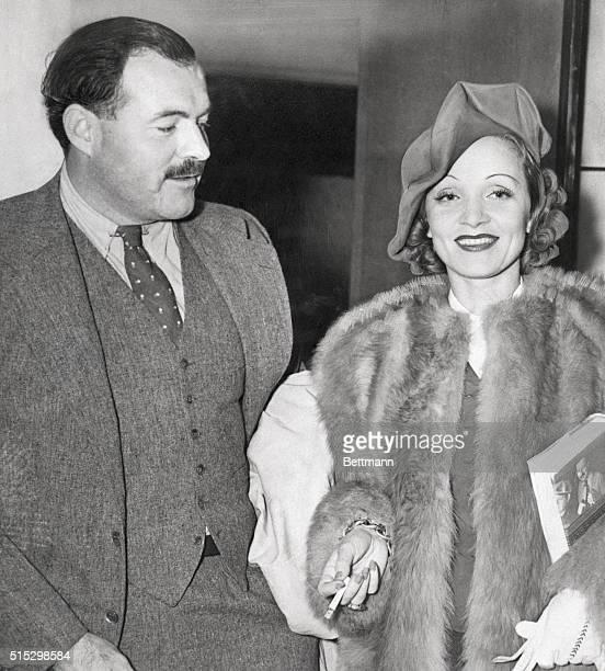 Ernest Hemingway arrives from European trip with friend Marlene Dietrich