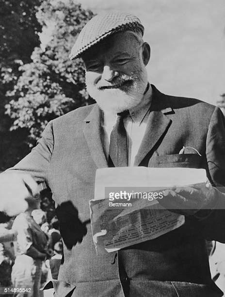 Ernest Hemingway at Longchamp for the Prix de l'Arc de Triomphe trying to pick a winner