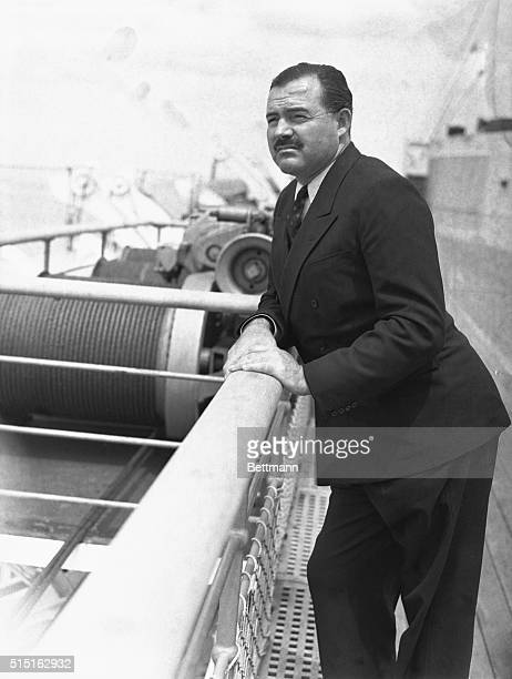 Ernest Hemingway, noted writer, pictured aboard the S.S. Normandie, on arrival in New York City, May 18th. He returned from Spain where he spent ten...