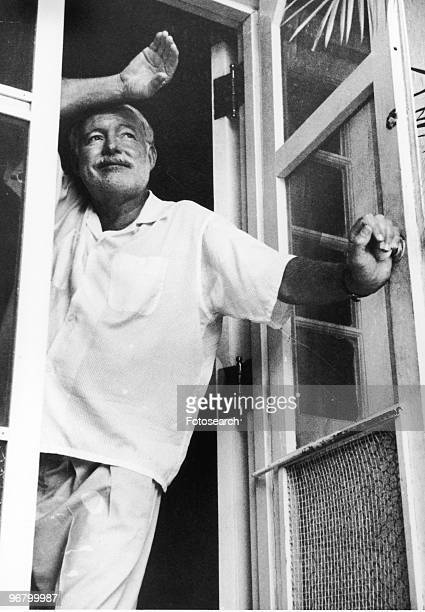 Ernest Hemingway standing looking out of doors circa 1960s
