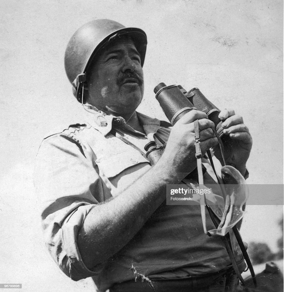 Ernest Hemingway wearing a uniform and holding binoculars, circa 1955. (Photo by Fotosearch/Getty Images).