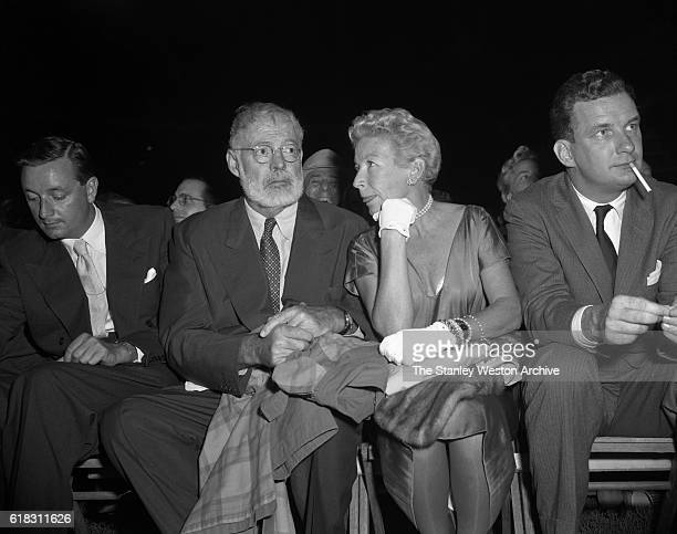 Ernest Hemmingway and his wife are one of the many spectators at the Carmen Basilio vs Sugar Ray Robinson middleweight title fight in Bronx New York...