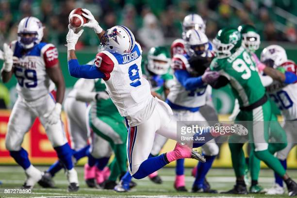 Ernest Jackson of the Montreal Alouettes makes a leaping catch in the game between the Montreal Alouettes and Saskatchewan Roughriders at Mosaic...
