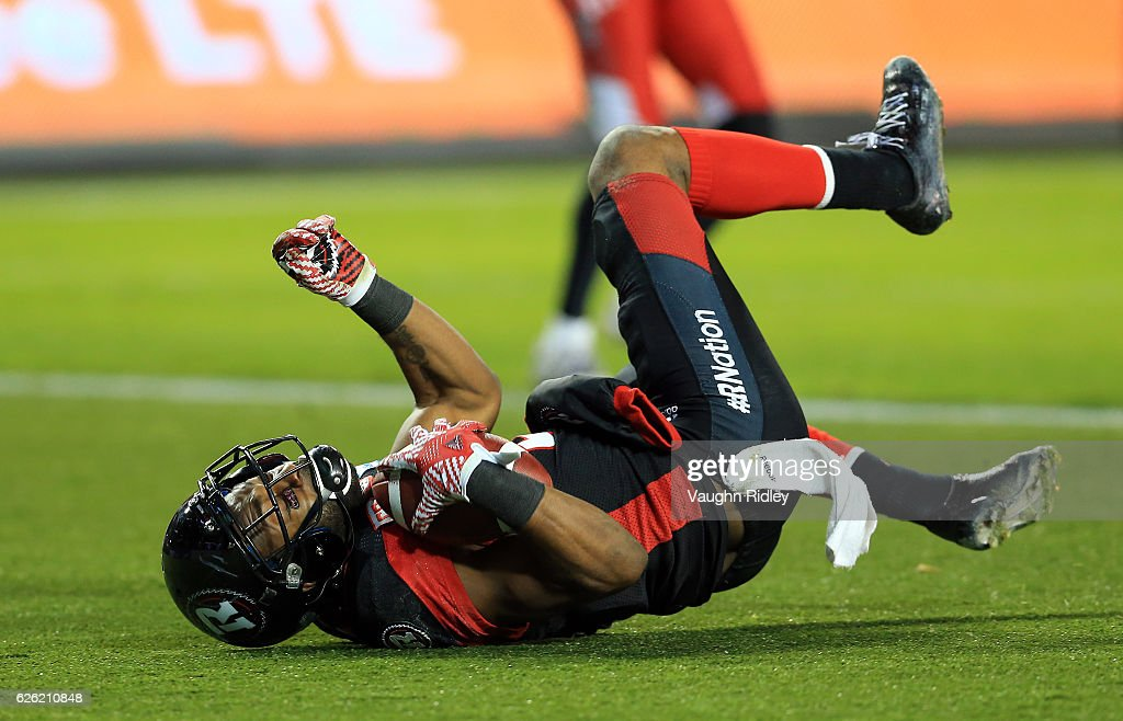 Ernest Jackson #9 of the Ottawa Redblacks scores a touchdown in overtime of the 104th Grey Cup Championship Game against the Calgary Stampeders at BMO Field on November 27, 2016 in Toronto, Canada.