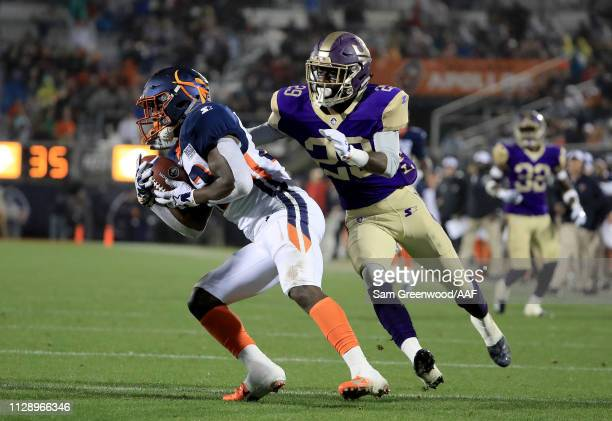 Ernest Johnson of Orlando Apollos is tackled by Damian Swann of Atlanta Legends during the Alliance of American Football game at Spectrum Stadium on...