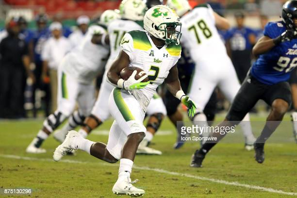 Ernest Johnson of South Florida carries the ball during the first half of the game between the Tulsa Golden Hurricane and the USF Bulls on November...