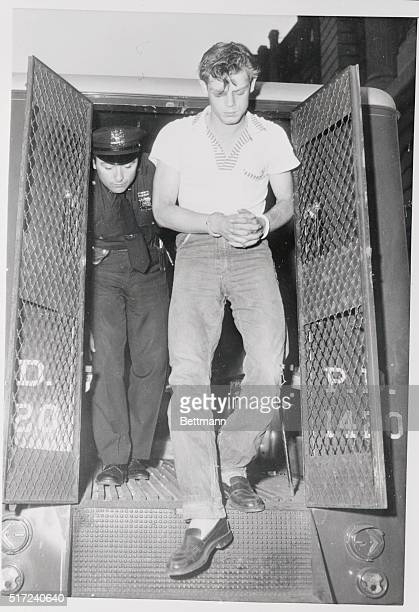 Ernest Lee Edwards leaves a paddy wagon at New York police headquarters here on July 7 to appear in a police lineup in connection with the alleged...