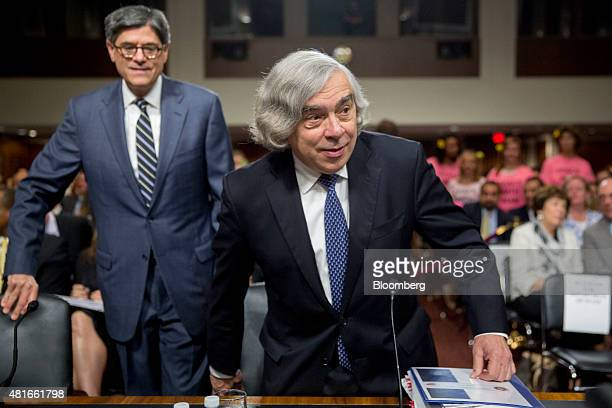 Ernest Moniz US secretary of energy right and Jacob 'Jack' Lew US Treasury secretary arrive to a Senate Foreign Relations Committee hearing in...