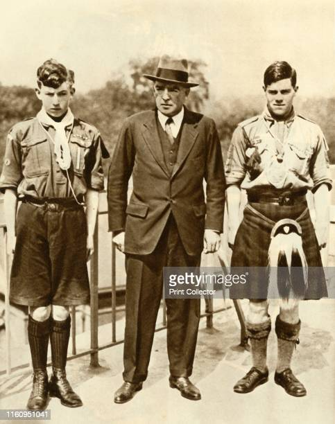 Ernest Shackleton with James Marr and Norman Mooney . British explorer Shackleton with boy scouts 'Marr and Mooney, specially chosen to accompany the...