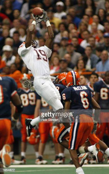Ernest Wilford of Virginia Tech makes one of his eight catches as Clifton Smith, Maurice Mcclain and Will Hunter of Syracuse try to defend at the...