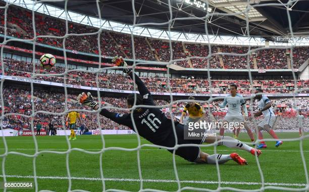 Ernestas Setkus of Lithuania fails to stop the shot from Jermaine Defoe of England for his side's first goal during the FIFA 2018 World Cup Qualifier...