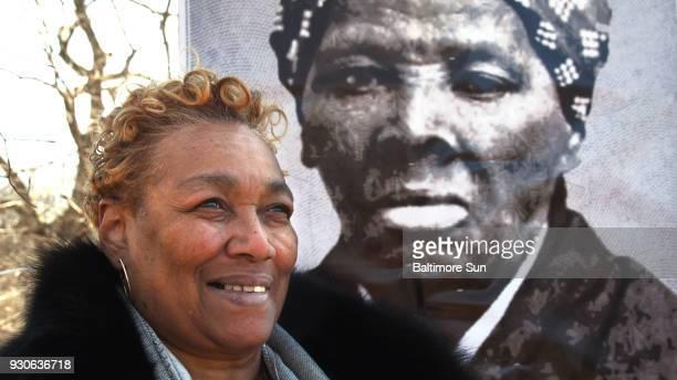 Ernestine Jones Williams a sixth generation niece to Harriet Tubman stands next to Tubman's portrait on Saturday March 10 2018 A portion of Wyman...