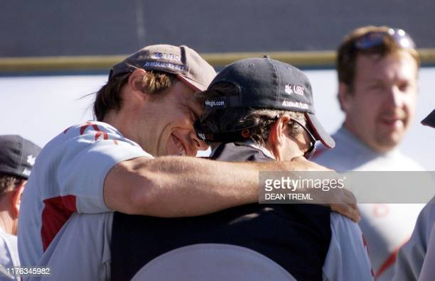 Ernesto Bertarelli , navigator, syndicate head and owner of Swiss syndicate Alinghi's yacht celebrates with skipper Russell Coutts after their match...
