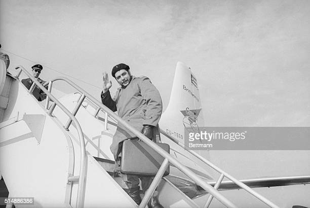 Ernesto Che Guevara Cuban minister of Industry waves as he boards a plane at Kennedy National Airport December 17th after spending eight hectic days...