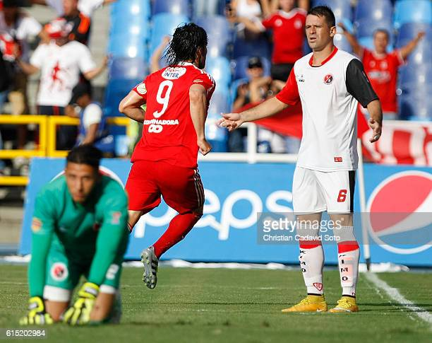 Ernesto Farias of America celebrates after scoring the first goal of his team during a match between America de Cali and Cucuta as part of round 16...