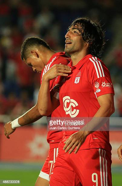 Ernesto Farias of America de Cali celebrates after scoring the first goal of his team during a match between America de Cali and Depor FC as part of...