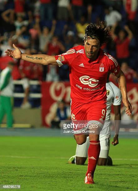 Ernesto Farias of America de Cali celebrates after scoring the second goal of his team during a match between America de Cali and Depor FC as part of...