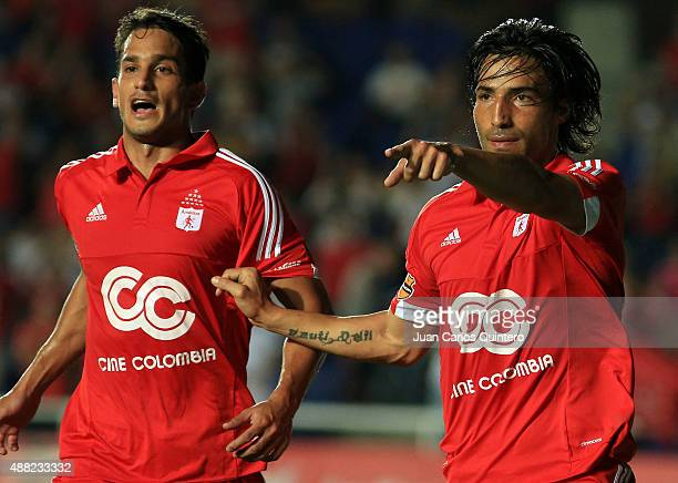 Ernesto Farias of America de Cali celebrates with his teammate after scoring the second goal of his team during a match between America de Cali and...