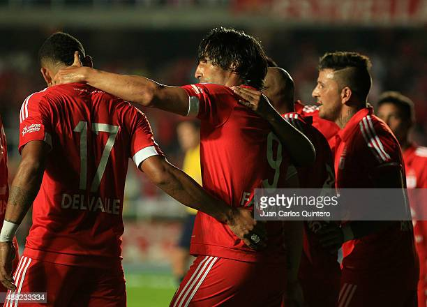 Ernesto Farias of America de Cali celebrates with his teammates after scoring the second goal of his team during a match between America de Cali and...