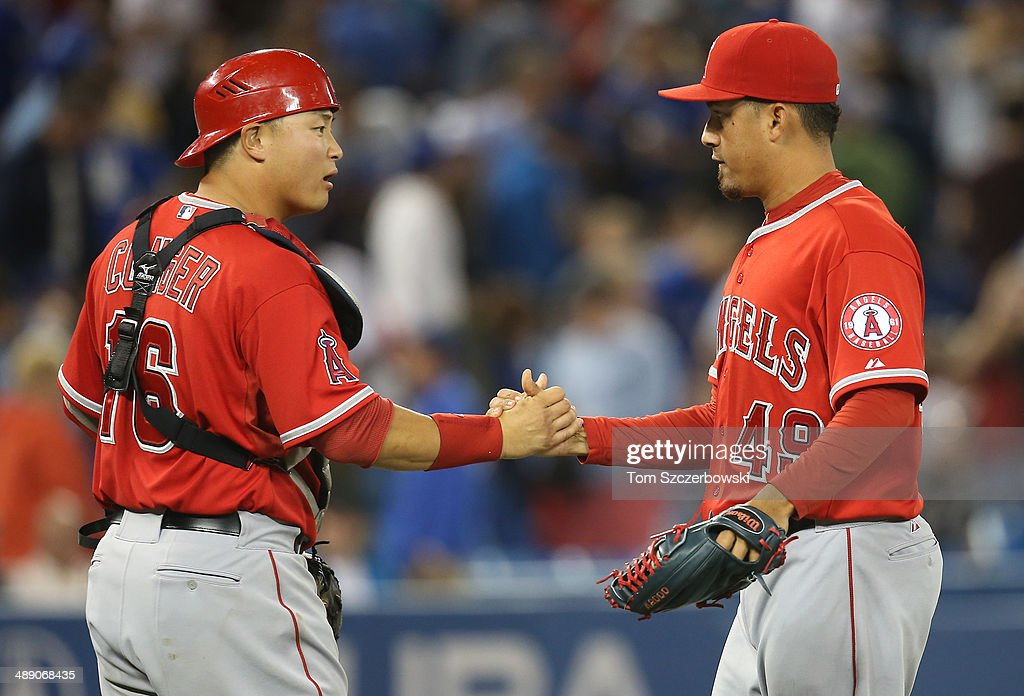 Ernesto Frieri #49 and Hank Conger #16 of the Los Angeles Angels of Anaheim celebrate a victory during MLB game action against the Toronto Blue Jays on May 9, 2014 at Rogers Centre in Toronto, Ontario, Canada.