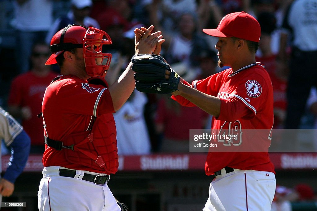 Ernesto Frieri #49 of the Los Angeles Angels of Anaheim celebrates with teammate Bobby Wilson #46 after the victory against the Los Angeles Dodgers in the interleague game at Angel Stadium of Anaheim on June 24, 2012 in Anaheim, California. The Angels won 5-3.