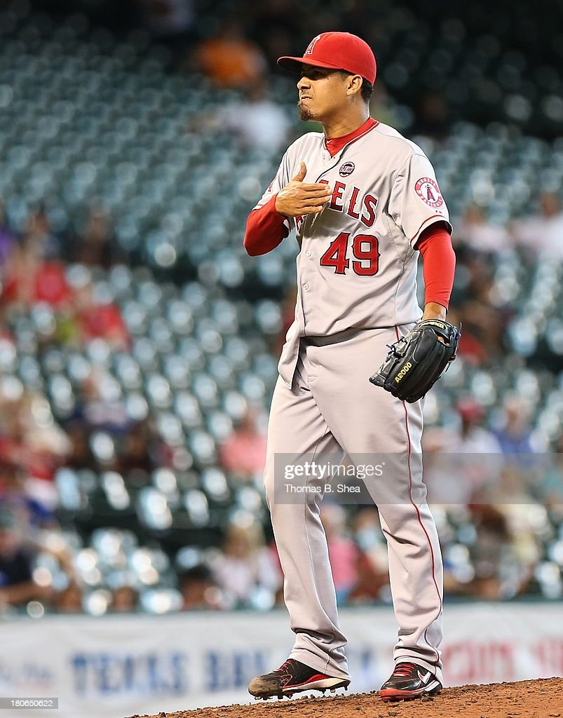 Ernesto Frieri #49 of the Los Angeles Angels of Anaheim pumps his fist after striking out Brandon Laird #4 of the Houston Astros in the ninth inning on September 15, 2013 at Minute Maid Park in Houston, Texas.