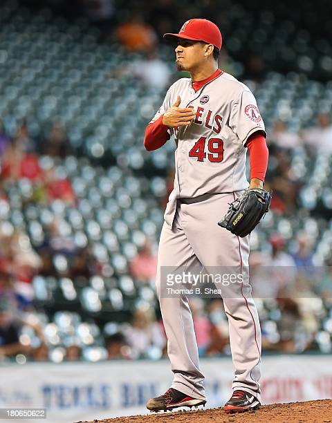 Ernesto Frieri of the Los Angeles Angels of Anaheim pumps his fist after striking out Brandon Laird of the Houston Astros in the ninth inning on...
