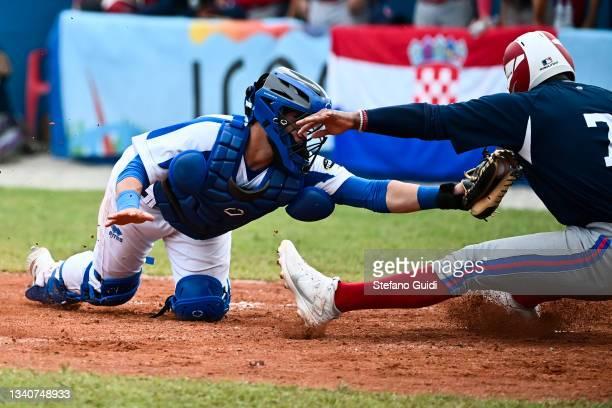 Ernesto Liberatore of Italy against Jose Herrera of Croatia during the European Baseball Championship match quarter final between Croatia and Italy...