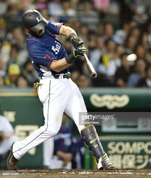 Ernesto Mejia hits a tworun home run his 10th home run of the season in the fourth inning of the Seibu Lions' 32 10inning loss to the Hanshin Tigers...