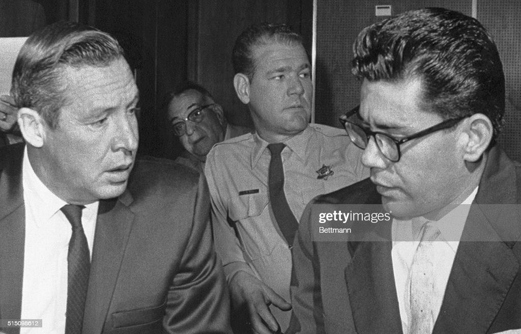 Ernesto Miranda Talking with Attorney : News Photo