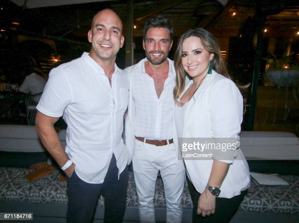 Ernesto Rodriguez spokesperson for the Miami Beach PD Julian Gil and publicist Laura Mejia Cruz pose at River Yatch Club during the US launch of...