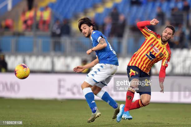 Ernesto Torregrossa of Brescia and Andrea Rispoli of Lecce compete for the ball during the Serie A match between Brescia Calcio and US Lecce at...