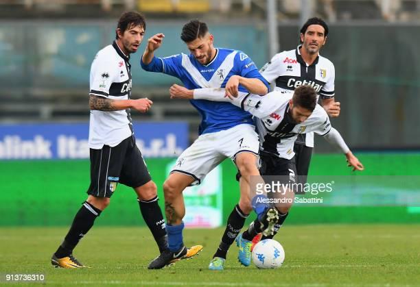 Ernesto Torregrossa of Brescia Calcio competes for the ball whit Manuel Scavone of Parma Calcio during the Serie B match between Brescia Calcio and...