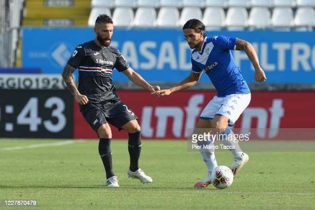 Ernesto Torregrossa of Brescia Calcio competes for the ball with Mehdi Leris of UC Sampdoria during the Serie A match between Brescia Calcio and UC...