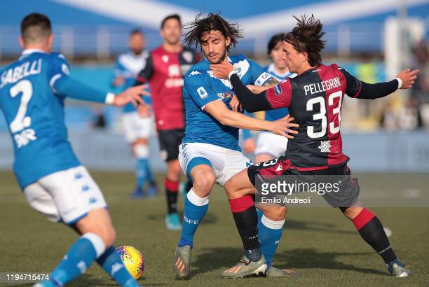 Ernesto Torregrossa of Brescia Calcio is challenged by Luca Pellegrini of Cagliari Calcio during the Serie A match between Brescia Calcio and...