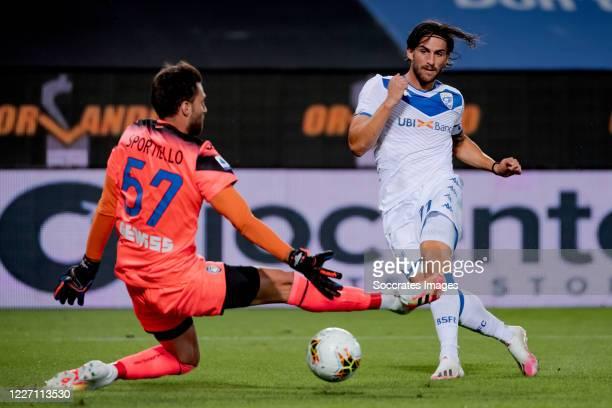 Ernesto Torregrossa of Brescia scores the second goal to make it 11 Marco Sportiello of Atalanta Bergamo during the Italian Serie A match between...
